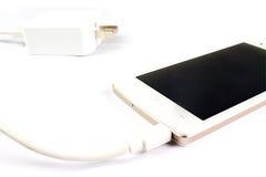 聪明的电话和适配器缆绳 免版税图库摄影