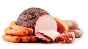 肉制品包括在白色和香肠隔绝的火腿 免版税库存照片