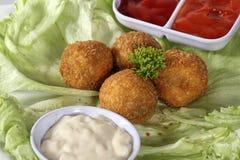 肉快餐球和调味汁 免版税库存图片