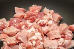 肉裁减成油煎的片断 免版税图库摄影