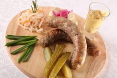 肉香肠用腌汁和调味汁 免版税库存图片