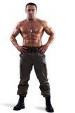 肌肉人摆在 免版税库存照片
