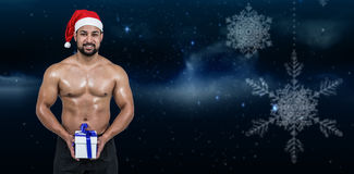 肌肉人的综合图象圣诞老人帽子的 图库摄影