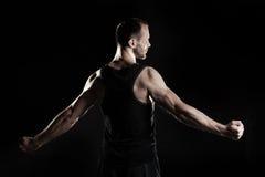 肌肉人,在拳头的钩子手,黑 图库摄影