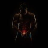 肌肉和蜡烛 库存图片