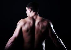 肌肉回到的人 免版税库存照片