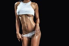 肌肉机体的女性 库存图片