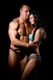 肌肉男人和妇女 免版税图库摄影