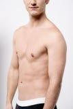 肌肉男性的中间部分 库存图片