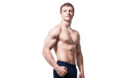 肌肉年轻人显示不同的运动 库存图片