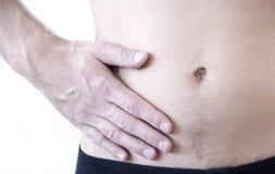 肠痈攻击  在右边的痛苦 肠痈攻击  痛苦在腹部,特写镜头的右边 库存照片