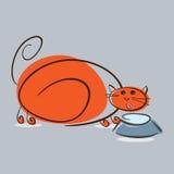 肥满红色猫饮用奶 免版税图库摄影