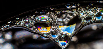 肥皂、泡影或者油创造的彩虹颜色 库存图片