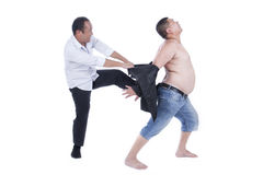 肥胖人民有困难在穿戴 免版税库存图片