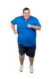 肥胖人运行中 库存照片