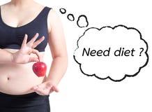 肥胖在白色隔绝的妇女亚洲举行苹果文本泡影需要饮食健康概念 免版税库存图片