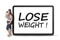 肥胖妇女与丢失重量文本 免版税库存图片