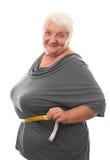 肥胖妇女测量的腰部 库存图片