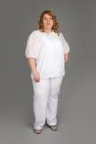 肥胖微笑的妇女 免版税库存图片
