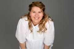 肥胖微笑的妇女 免版税库存照片