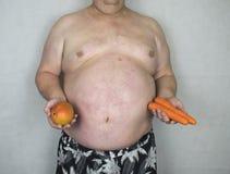 肥胖病-肥胖人用果子& Veg 免版税库存照片
