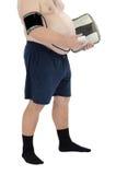 肥腻举行标度和血压测量仪 免版税库存照片