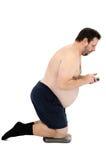 肥腻对医生的kneening在等级和电话 库存照片
