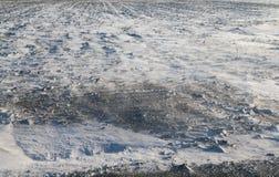 肮脏和吹的雪 免版税库存照片