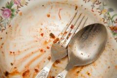 肮脏的板材食物 免版税图库摄影