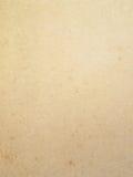 肮脏的棕色老纸背景 库存图片