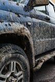 肮脏的汽车的侧视图 免版税库存图片