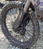 肮脏的轮子摩托车 库存照片