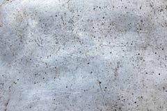 肮脏的金属背景,与损坏的纹理的老铁板料 免版税库存图片