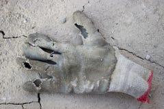 肮脏的防护手套 免版税库存图片