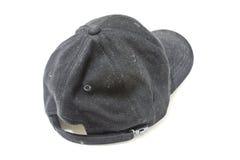 肮脏老黑的盖帽 免版税库存照片