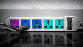 肮脏,多灰尘和被用完的五颜六色的引伸Electical插口  免版税库存图片