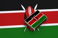 肯尼亚旗子在一面大旗子说谎的火柴盒被生动描述 库存图片