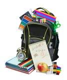 背包充分的学校用品 免版税库存图片