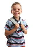 背包幸福男小学生与 免版税库存照片