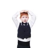 背心的一点红头发人男孩,惊奇隔绝在白色 免版税库存照片