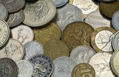 背景不同硬币的国家(地区) 免版税库存图片