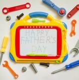背景为父亲节,与文本和玩具instr的一个地方 免版税库存照片