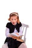 背景书女孩查出在纵向读取少年白色 库存图片