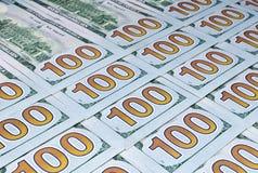 背景倒置一百元钞票 免版税库存照片