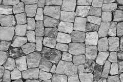 背景做石石头纹理墙壁白色 黑白石美好的表面 免版税库存图片
