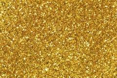 背景充满发光的金子闪烁 库存照片
