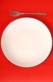 背景叉子牌照红色白色 免版税库存图片