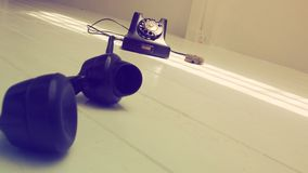 背景古色古香的电话和减速火箭的照片透视dimensi 库存图片