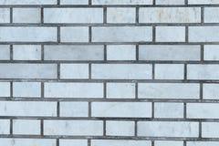 背景和纹理的灰色砖墙 图库摄影