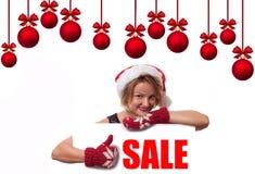 背景圣诞节女孩愉快的销售额购物白色 节假日 美丽的帽子圣诞老人妇女 免版税库存图片